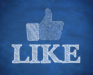 Thumb up representing social network logo above the word likeの素材 [FYI00488259]