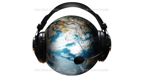 Ear Phones and ear Piece around a Globeの写真素材 [FYI00488289]