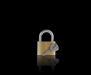 Locked padlock with keyの素材 [FYI00488343]