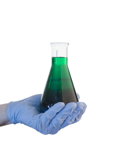 Hand holding out chemicalsの素材 [FYI00488427]