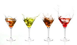 Serial arrangement of coloured liquids splashing in cocktail glassの写真素材 [FYI00488503]