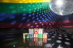 Block spelling gay pride under light of disco ballの写真素材 [FYI00488568]