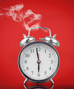 Smoking hot alarm clockの写真素材 [FYI00488597]