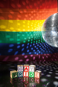 Blocks spelling out gay pride under light of disco ballの写真素材 [FYI00488649]