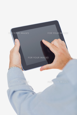 Hands using digital tabletの写真素材 [FYI00488777]