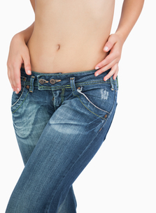Midsection of slim woman in jeansの写真素材 [FYI00488813]