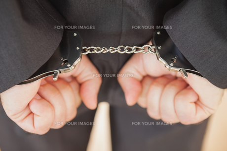 Attrested businessman clenching fistsの写真素材 [FYI00488831]