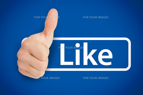 Real thumb up next to the like from social networksの素材 [FYI00488870]