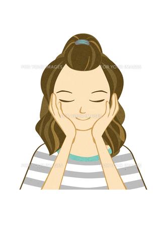 顔に手を当てる女性の写真素材 [FYI00495945]