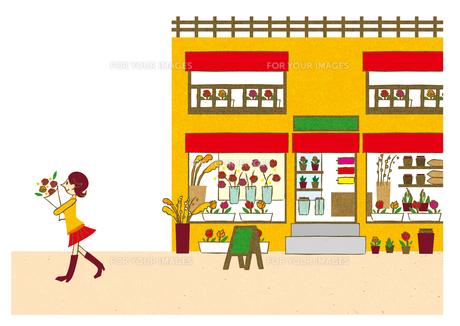 お花屋さんで買い物する女の子の写真素材 [FYI00497175]