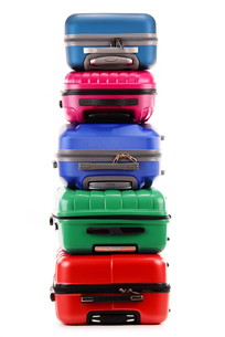 Stack of plastic suitcases isolated on whiteの素材 [FYI00631620]