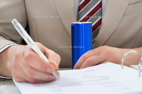 Businessman With Drink Can And Documentの写真素材 [FYI00634017]