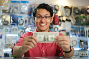 Happy Chinese Man Showing First Dollar Earning In PC Shopの写真素材 [FYI00634107]