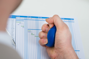 Businessperson Pressing Stressballの写真素材 [FYI00634119]