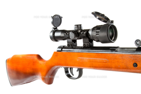 air rifle with a telescopic sight and a wooden buttの写真素材 [FYI00634511]