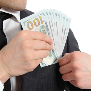 Close up of a business man hand keeping money in his pocketの写真素材 [FYI00634794]