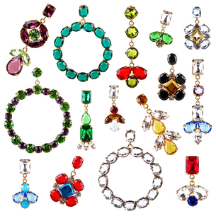 beautiful colorful crystal earrings collection isolated on whiteの写真素材 [FYI00635402]