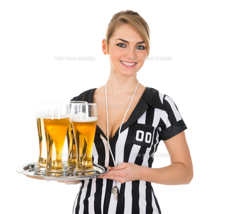 Female Referee With Glass Of Beerの素材 [FYI00636760]