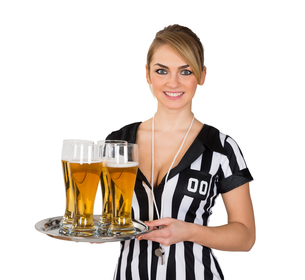 Female Referee With Glass Of Beerの素材 [FYI00636762]