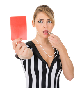 Female Referee With Red Card And Whistleの素材 [FYI00636767]
