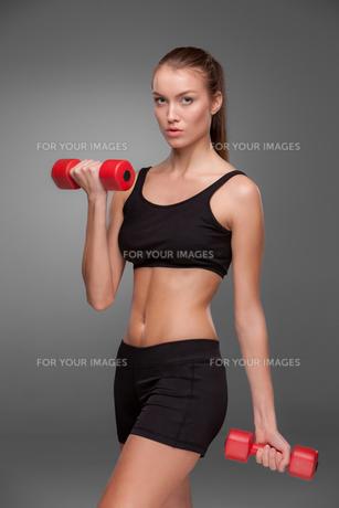 Sporty woman doing aerobic exerciseの写真素材 [FYI00637313]