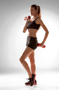 Sporty woman doing aerobic exerciseの写真素材 [FYI00637324]