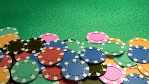 casino chips show hand green tableの写真素材 [FYI00638056]