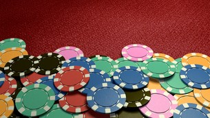 casino chips show hand red tableの写真素材 [FYI00638057]