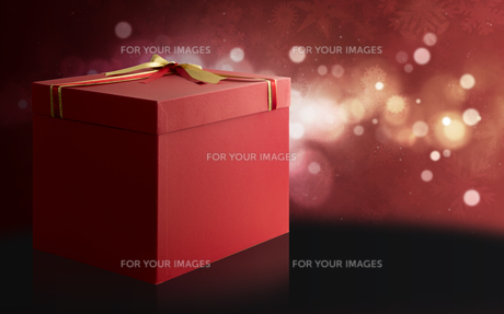 Gift Box over a red and black Christmas background.の写真素材 [FYI00638812]