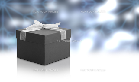 Christmas Gift Box with blue backgroundの写真素材 [FYI00638816]