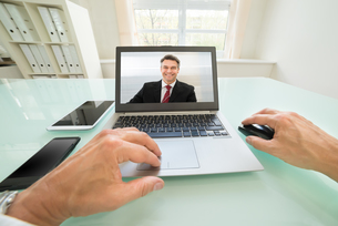 Person Having Videochat With Businessmanの写真素材 [FYI00640430]