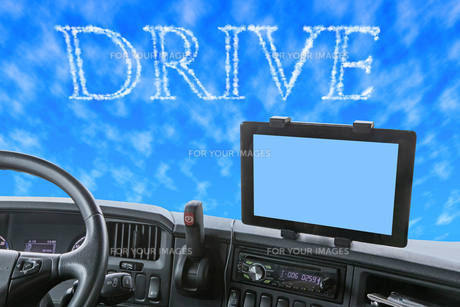 Dashboard of the truck with Drive word in the blue skyの素材 [FYI00641399]