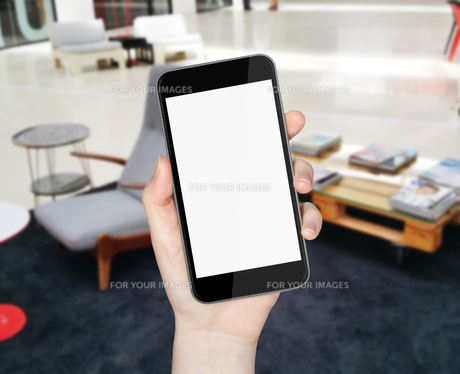 Hand with mobile phoneの写真素材 [FYI00641400]