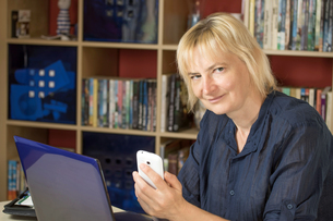 The middle aged woman at home officeの写真素材 [FYI00641403]
