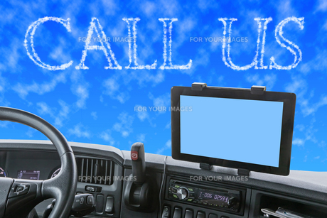 Dashboard of the truck with CALL US words in the blue skyの素材 [FYI00641405]