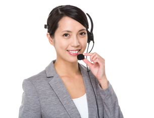 Young businesswoman with headsetの写真素材 [FYI00641674]