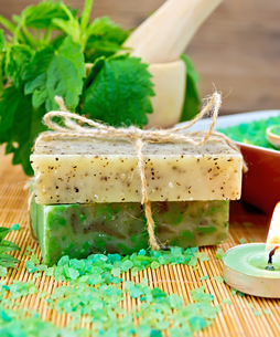 Soap homemade and candle with nettles in mortar on boardの写真素材 [FYI00641933]