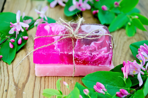 Soap homemade pink with flowers of honeysuckleの写真素材 [FYI00641943]
