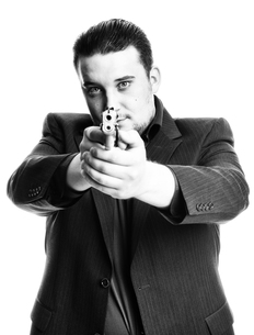 agent aiming with gun in black and whiteの素材 [FYI00642753]