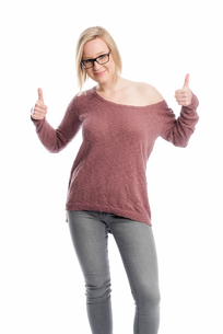 young woman with glasses showing thumbs upの素材 [FYI00642769]