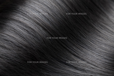 Closeup on luxurious glossy black hairの写真素材 [FYI00643028]