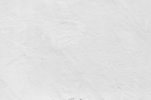 Grungy white concrete wall backgroundの写真素材 [FYI00643295]