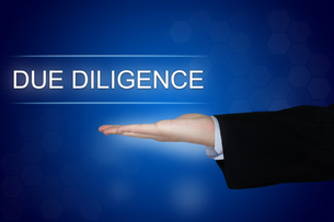 Due diligence button on blue backgroundの写真素材 [FYI00643497]