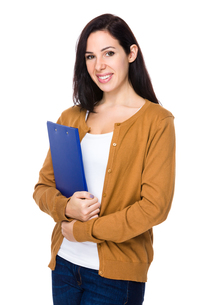 Brunette Woman hold with clipboardの写真素材 [FYI00643947]
