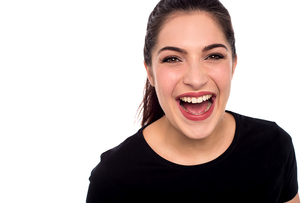 Young woman laughing loudの写真素材 [FYI00644119]