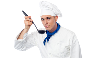 Handsome male chef tasting a dishの写真素材 [FYI00644163]