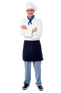 Handsome young chef posing in uniformの写真素材 [FYI00644174]