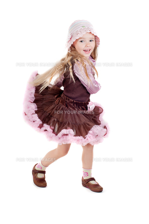 Dancing happy little girl in pink tutu skirtの写真素材 [FYI00644250]