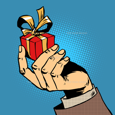 gift in his hand a small box pop art comics retro style Halftoneの写真素材 [FYI00644378]