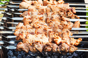 skewers with pork shish kebabs on roasterの写真素材 [FYI00644503]